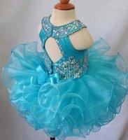blau kleinkind cupcake festzug kleider großhandel-Blue Jewel rückenfreie Perlen Bogen Organza Blumenmädchen Cupcake Festzug Kleider Kinder Kleinkind Glitz prom Infant Ballkleider