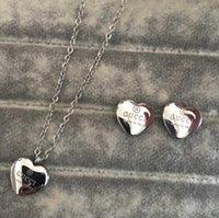 ingrosso collane nuove-Nuovi collane di lusso gioielli in acciaio 316L titanio placcato in oro 18 carati Collana pendente in argento con orecchini set per regalo donna