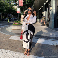 falda enagua naranja al por mayor-Diseñador de verano para mujer Faldas largas Estampado floral Negro Blanco Estilo de moda Ropa femenina Ropa casual sexy