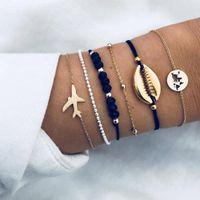 flache armbänder großhandel-DreamBell 6pcs / set Frauen Armband Mode Shell / Flugzeug / Karte / Perle Delicate Armband Weiblichen Schmuck