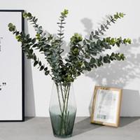 künstliche blattdekorationen großhandel-Künstliche Pflanzen Weichplastik Eukalyptus Grünpflanzen Wohnkultur Gefälschte Pflanzenblätter Hochzeitsdekoration Simulation Bonsai