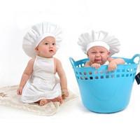 chapéu fedora bebê crianças venda por atacado-Bebê Branco Cozinheiro Avental Traje Do Bebê Chapéu Recém-nascido Fotografia Props Fotografia Chapéus Para Meninas Cap Crianças Acessórios Do Bebê dhl