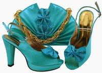 kelebek mavi tasarımlar toptan satış-Yeni moda sky blue kadınlar pompalar ve çanta set kelebek tasarımı ile afrika ayakkabı maç çanta elbise için MM1079, topuk 11.5 cm