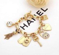 ingrosso qualità dei monili della lega-Braccialetto di design gioielli in argento / oro colore 21cm lega di alta qualità pendente cuore chiave blocco braccialetto accessori moda braccialetto B029