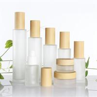 mattglas spray großhandel-20ml 30ml 40ml 50ml 60ml 80ml 100ml Frostglas-Cremetiegel mit Holzdeckeln Kappe Milchglas-Lotion Sprühflasche