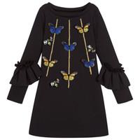 vestido largo color mariposa al por mayor-Venta al por menor vestido de niña bebé bordado de abeja mariposa manga larga vestidos negros niños faldas casuales niños boutique ropa de diseñador