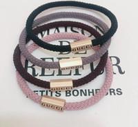 ingrosso fasce elastiche in metallo-All'ingrosso New Fashion Luxury elastici per capelli cravatte moda banda capelli bracciali fascia accessori per ornamenti con fibbia in metallo moda