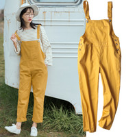 mono amarillo para las mujeres al por mayor-Estilo coreano Preppy Big Pocket sueltos monos Streetwear Salopette Femme Dungarees para mujeres tirantes verde amarillo mono Y19060501