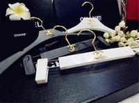 Wholesale white clothes hangers resale online - Resin Plastic Racks Hanger Clothes Shop Coat Hanger Black White Trousers Rack Fashion Logo Hanger Wedding Dress Business Suit Racks