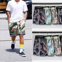 ingrosso justin bieber stampato vestiti-Pantaloncini da spiaggia Hawaii Pantaloncini Justin Bieber High Street Pantaloncini allentati stampa floreale Pantaloncini Hip Hop Abbigliamento da mare