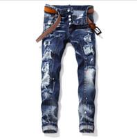ingrosso jeans di collant di moda-Mens Designer jeans alla moda di cucitura Maschio Tight-fitting jeans strappati Vernice spruzzi Pantaloni blu di modo di marca dei jeans Asiatica Misura 30-38