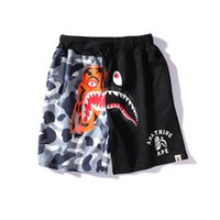 Wholesale stitched flats for sale - Group buy Bape Mens Short Pants Fashion Designer Mens Summer Graffiti Printing Pants Black And White Camouflage Stitching Shorts