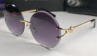 ingrosso taglio rotondo diamanti-Nuove donne di moda occhiali da sole 6014 Lente di taglio rotondo senza frammenti di diamante di design d'avanguardia stile di alta qualità protezione uv