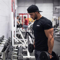 Wholesale fitness professional shirts for sale - Group buy 2019 Men Gym Professional Training T Shirt Fitness Bodybuilding Short Sleeve Cotton Shirts Workout Clothes Crossfit Tee Tops Clothing