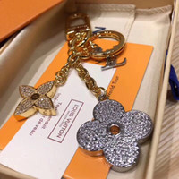 Wholesale charm flower keychain resale online - Fashion Silver Flower Keychains Original Stainless Steel Famous Luxury Designer Keychain Charm Pendant for Gifts with Box