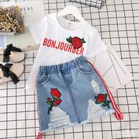 gestickte hemden für mädchen großhandel-Einzelhandelsmädchenausstattungen stickten Rose 2pcs Kleidungs-Satzhemd + Denimröcke beiläufige Klagendesignerkleidungsbaby-Trainingsanzugkindboutique