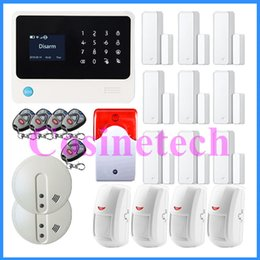 Wholesale Personal Controller - quad-band GSM WIFI Alarm system with 9 door magnet sensor+4 PIR detector+4 remote controller+2 smoke sensor fire alarm+siren