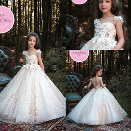Wholesale Making Knots - 2018 New Champagne Short Sleeves Girls Pageant Dresses Knot Delicate Beaded Sequins Applique Ball Gown Floor Length Flower Girls Dresses