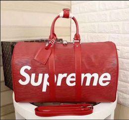 Wholesale Travel Bag Branded - red new fashion men women travel bag duffle bag, brand designer luggage handbags large capacity sport bag