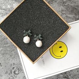 Wholesale Import Flowers - South Korea imported Dongdaemun new jewelry cross bow hair woolen ball pendant female earrings