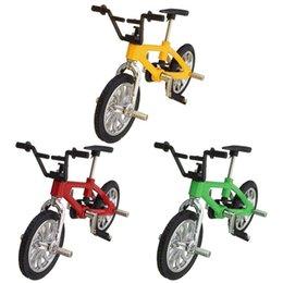 4 colores del dedo del bebé juguetes de la bicicleta pequeño modelo de aleación de bicicleta en miniatura Diecast arte de la bicicleta del escritorio de escritorio decoración del hogar juguete del niño desde fabricantes