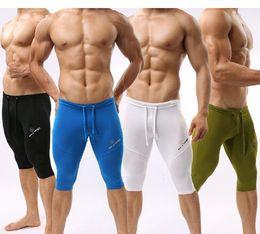 Wholesale Tight White Sleepwear - 10 pcs lot sales 2015 new arrival High elastic swimming Mens Middle Yoga Pants Fitness Sleepwear Soft Tight Swimwear