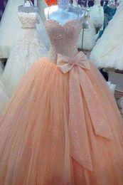 Bling orange prom vestidos on-line-Brilhante Lantejoulas Bling Princesa Vestido De Baile Vestidos de Baile Laranja Do Vintage Quinceanera Vestidos de Festa Com Arco Cintas de Espaguete Até O Chão