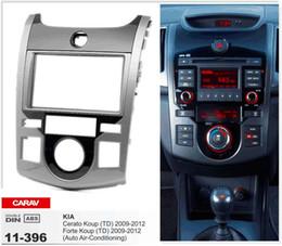 Radios kia forte online-CARAV 11-396 Fascia de radio de alta calidad para KIA Cerato Koup (TD), Forte Koup (TD) Kit de instalación de trípode Stereo Fascia Dash CD