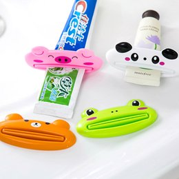 Wholesale rolling monkey - Cute Animal Multifunction Squeezer Bathroom Home Tube Rolling Holder Squeezer Easy Cartoon Toothpaste Dispenser Frog Pig Monkey Tiger 500Pcs