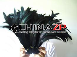 CHINAZP Fabrik 100 teile / los Größe von 12 zoll bis 14 zoll (30-35 cm) Einzigartige Gefärbte Schwarze Hühnerhahn Schwanzfedern von Fabrikanten