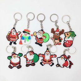 Wholesale santa christmas keys - 5cm Santa Claus Key Chains Christmas Gift Soft PVC Keychain KIDS TOYS Christmas Tree Ornaments Mixed Designs ZA5124