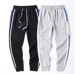 Pantalon en coton de couleur pour femme en Ligne-sup Marque de vêtements Hommes Pantalons de femmes Taille élastique KANYE WEST ruban de couleur Coton casual solide Joggers Pantalons
