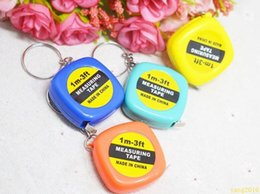 Wholesale wholesale measuring tapes - New 200pcs Small tape measure 1 meter portable mini soft tape measure ruler keychain pendant small gifts gift metric inch tape measure