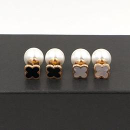 Canada Top qualité en acier inoxydable 316L trèfle boucles d'oreilles perle naturelle boucles d'oreilles pour les femmes rose or blanc et trèfle noir prix de gros cheap natural white pearls Offre