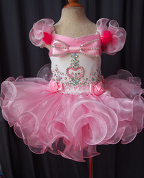 Wholesale Glitz Infant Dresses - 2015 Lovely Pink Glitz Little Girl Pageant Dress Cap Sleeve Bow Crystal Beaded Ruffle Short Kids Infant Party Gowns