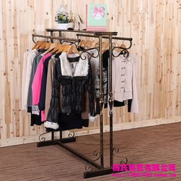 Wholesale Garment Young - Young wrought iron clothing rack clothing store display racks for hanging clothes rack in the island shelf garment rack floor