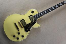Hardware personalizzato per chitarra online-Vendita calda Custom Shop Randy Rhoads Rosewood / Ebony Fingerboard Cream Yellow Electric Guitar Hardware dorato Spedizione gratuita