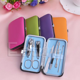 Wholesale Pink Clippers - 7pcs Portable Manicure Set Nail Care Clippers Scissors Travel Grooming Kits Case Tool Blue Green Hot Pink Orange Purple