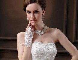 Wholesale Ribbon Accessories - HOT Sale New Arrival Cheap In Stock Bridal Gloves Lace Appliques Beads Fingerless Wrist Length With Ribbon Bridal Gloves Wedding Accessories