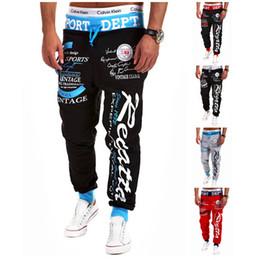 Pantalones holgados blancos para hombre online-Pantalones de chándal al por mayor-hombres Moda 2015 Nuevos Joggers para hombre Pantalones deportivos de chándal Cool Harem Pantalones deportivos de jogging blancos Hip Hop holgados