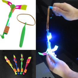 Wholesale Led Helicopter Sling - 24PCS Lot Children Fun LED Light Flying Sling Helicopter Rocket Arrow Toy Frisbee Flyer Boomerang Toy Free Shipping