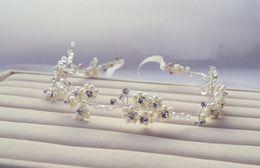 2019 головные цветы для волос невесты 2015 роскошный жемчуг цветы аксессуары горный хрусталь невесты ремни для волос пляж свадьба повязки аксессуары TS00170 скидка головные цветы для волос невесты