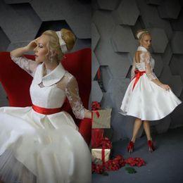 Argentina Vestidos de novia de encaje corto con ilusión mangas largas por encargo Vestidos de novia de playa corto con mini vestido de coctel cinta roja Suministro