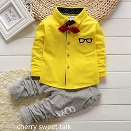 Wholesale System Clothes - Wholesale- Children age baby clothes casual game system of children clothes pants are of good quality white yellow coat