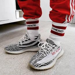Canada 18ss chaussettes de basket-ball vetements rayures rouges chaussettes de coton noir blanc planche à roulettes hip hop sport de la rue haute chaussettes midtop HFLSWZ004 Offre