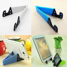 Soportes para móviles online-10Pieces / Lot Tenedores de teléfono celular multicolor Tenedores de teléfono móvil plegable material de PC para el escritorio