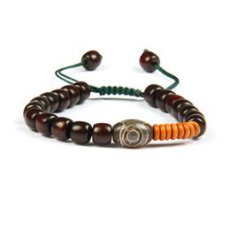 d24058e7700f Joyería de moda al por mayor 10 unids   lote cuentas de madera naturales  tibetano unisex Dzi ojo Yoga meditación étnica macrame pulsera