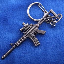 Wholesale Gun Metal Game - COOL Hot Game Pendant Keyrings Pop Game Cross Fire Gun Key Chains Weapon 3d Model Metal Pendant Keychain Metal Key Ring