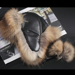 3205477d808 Wholesale- 2017 New Style Women s Raccoon Fur Hats with Leather Tops Ear  Flaps Bomber Hats Russian Ushanka outdoor Leifeng Fox Fur Caps
