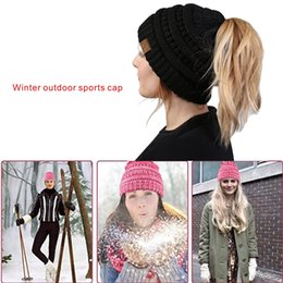Wholesale Running Cable - Winter outdoor sports keep warm cap Soft Stretch Cable Knit Messy High Bun Ponytail Beanie Hat.